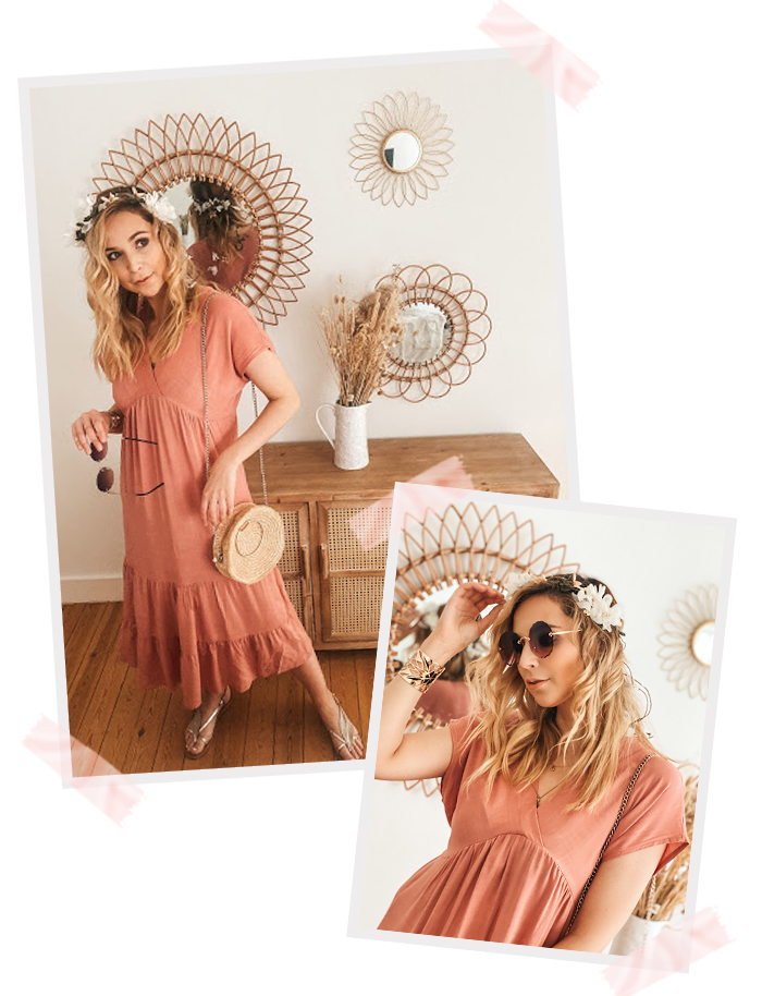 Helena wearing a bohemian pink dress standing in front of a dresser with mirrors on the wall. Wearing golden sandals on her feet and sunglasses in her hand and a crochet bag on her shoulders.